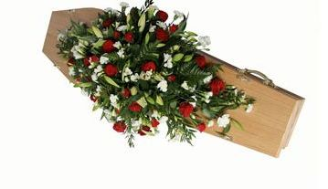Large double-ended coffin spray with lilies....
