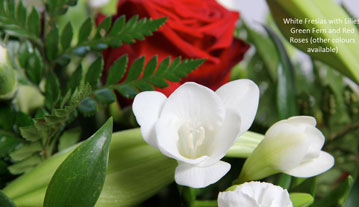 White fresias with lilies, green fern & roses